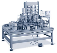 Three model B rivet setters are used with a twelve fixture index table and four vibratory feeder placement devices