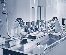Five Model 1600 Riveters with an automatic 3-position slide fixture sets ten self-piercing rivets in an air conditioner panel assembly