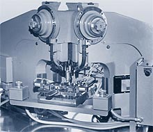 Three pneumatic riveters, with automatic shuttle, aligns motor lamination stack and housing and sets three rivets
