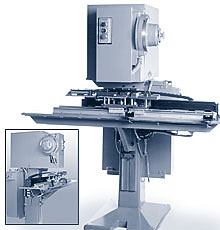 A Model 800 rivet setter is equipped with a sound dampening enclosure and a lead screw powered programmable in-line shuttle fixture